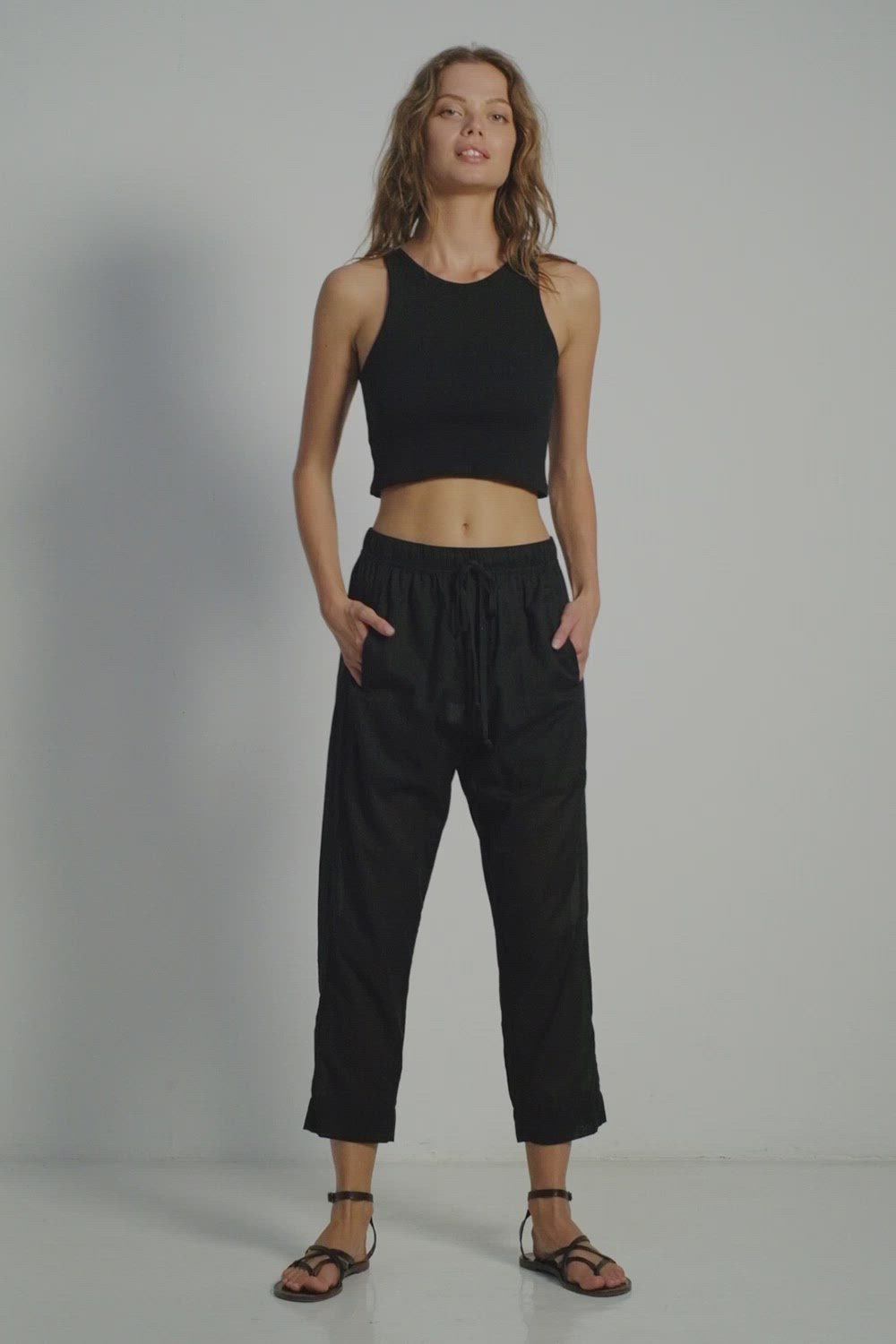A woman wearing summer look by Lilya: black cotton casual pants and black crop top