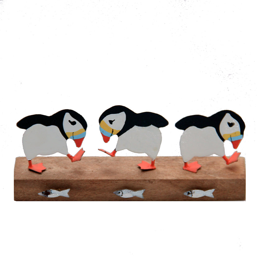 Three puffins on wood