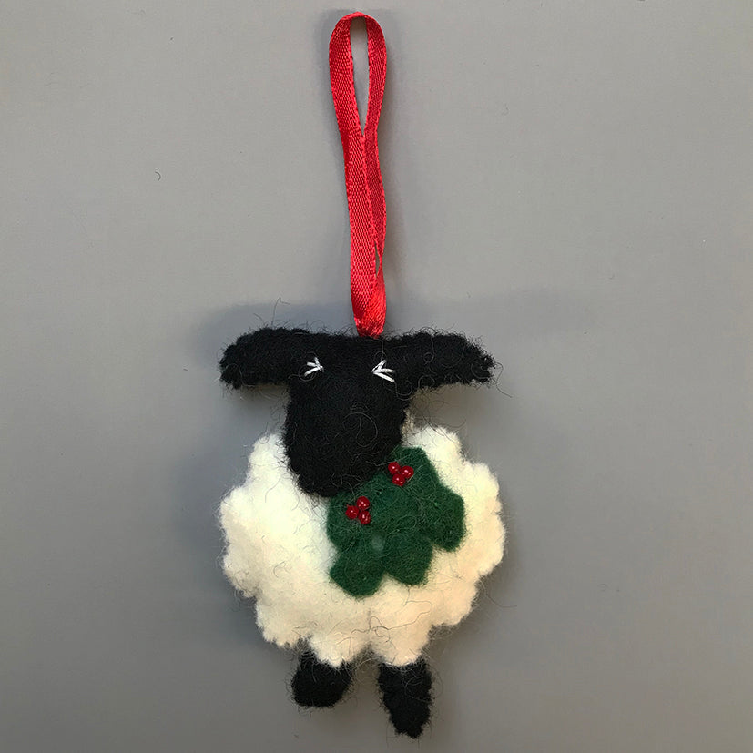 sheep with holly decoration