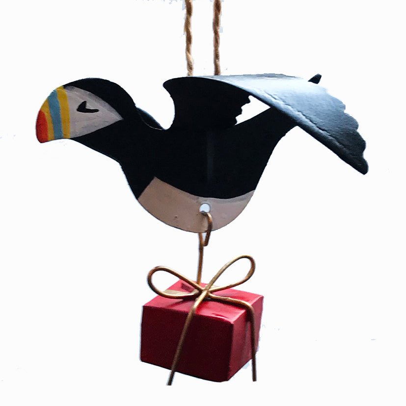 Hanging puffin with a gift