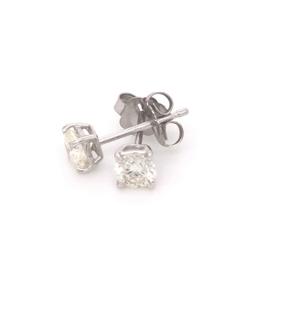 14k .50ctw diamond stud earrings