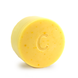 Citrus Shine conditioner bar for curly hair scented with orange bergamot and litsea cubeba essential oils contains calendula chamomile and turmeric all natural colour