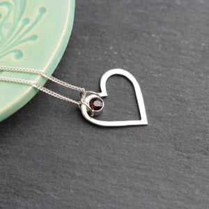 Silver Heart Necklace with a faceted red garnet