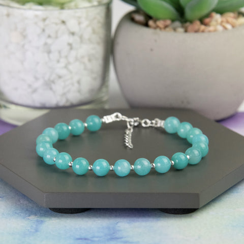 Bright turquoise amazonite bead bracelet with a sterling silver clasp.  Amazonite beads are seperated by tiny sterling silver beads.