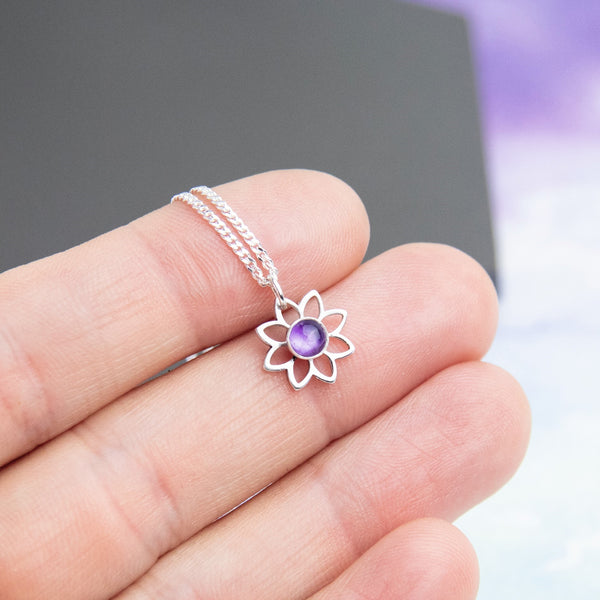 Sterling silver flower pendant with a purple amethyst in the centre