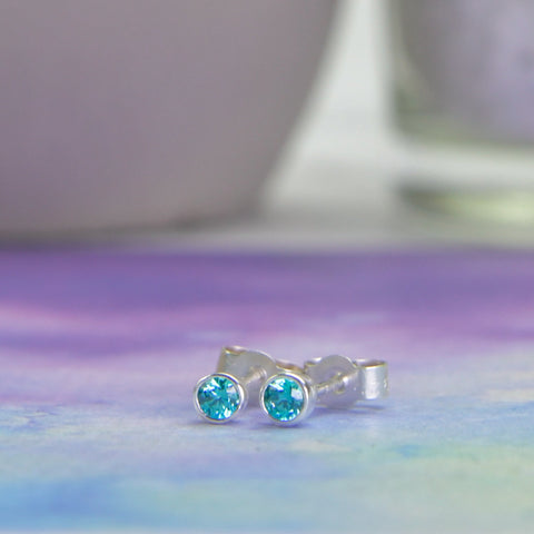 Bright blue zircon studs set in sterling silver
