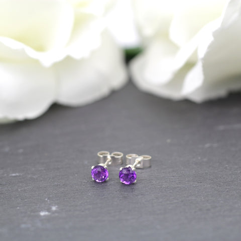 Vibrant purple amethyst gemstones set in sterling silver claws