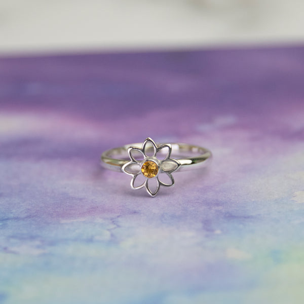 Silver Flower ring with a yellow citrine gemstone in the centre