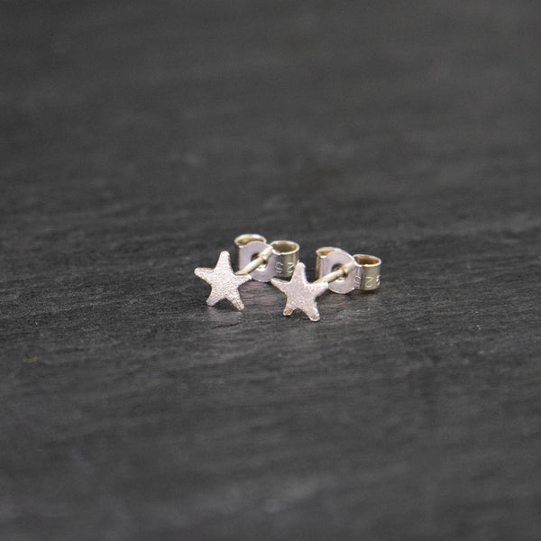 Small sterling silver star studs