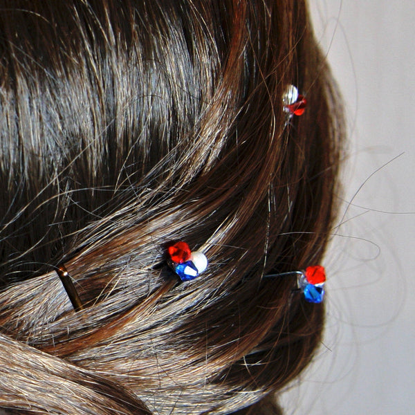 Hair pins in a hairstyle so that only the crystals are visible.