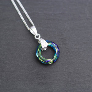 Swarovski Bermuda Blue Pendant hanging on a sterling silver chain