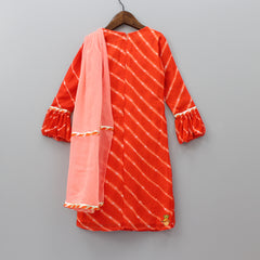 Pre Order: Orange Leheriya Kurta With Peach Draped Dupatta And Churidaar