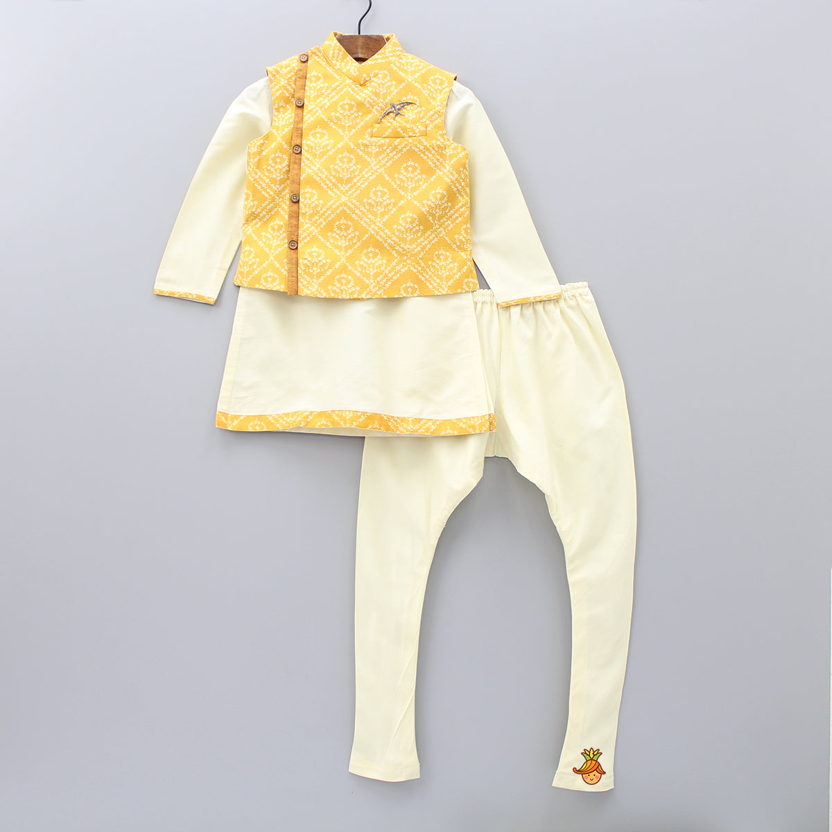 Pre Order: Cream Kurta And Churidar With Yellow Bandhej Jacket