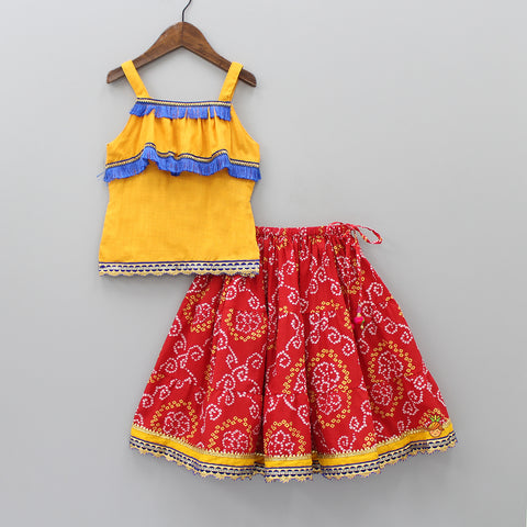 Mustard Yellow Top And Red Bandhani Print Lehenga