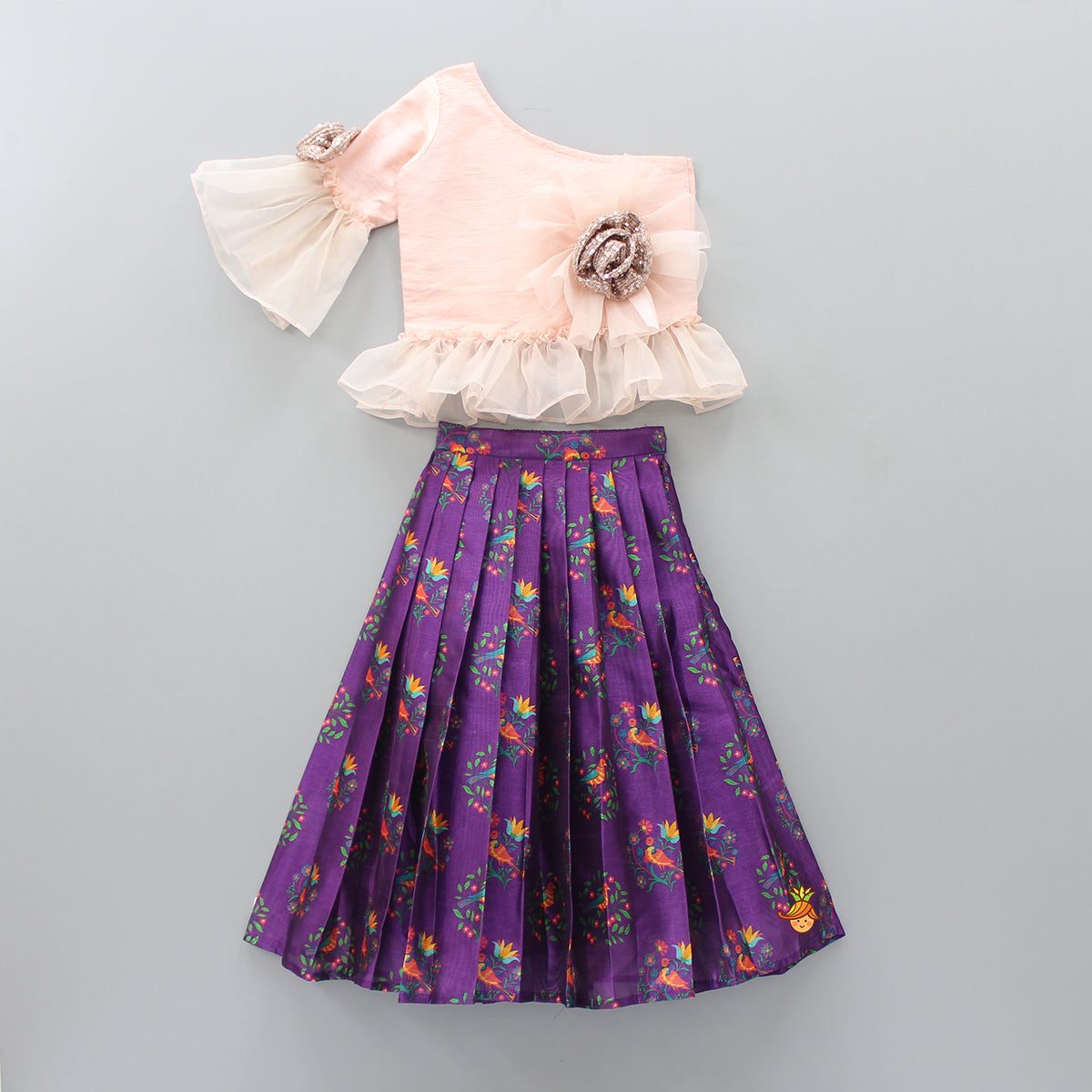 Pre Order: One Shoulder Light Peach Top And Purple Printed Lehenga