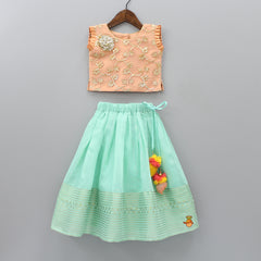 Pre Order: Peach Floral Top And Aqua Green Lehenga With Dupatta