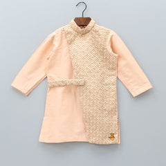 Pre Order: Peach Embroidered Sherwani And White Churidar
