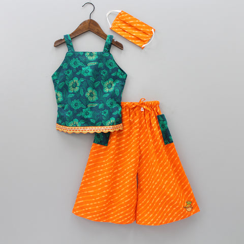 Green Top With Orange Palazzo Pants And Mask