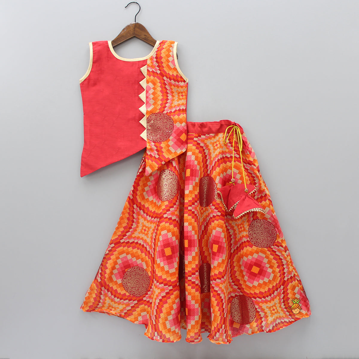 Asymmetric Orange Top With Printed Ghagra