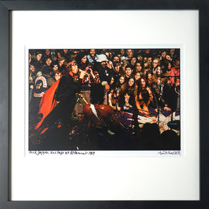 Framed, signed and titled 8x10 archival print of Mick Jagger onstage at Altamont  (One only)