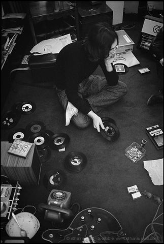 John Lennon with 45s London 1968