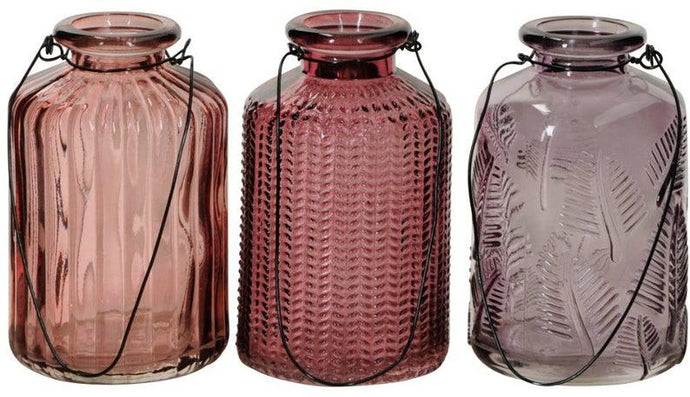 Pink glass hanging bottles