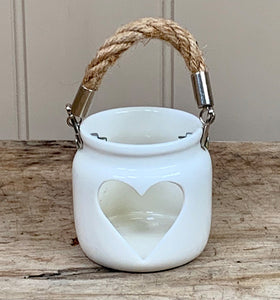 White t light holder with heart cut out and rope handle