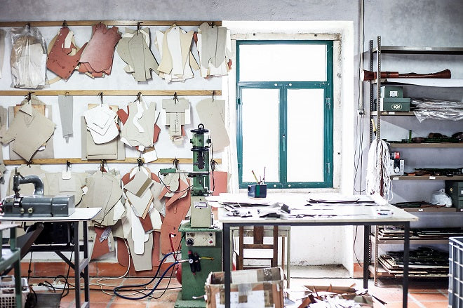 leather workshop view with patterns and die-cutters