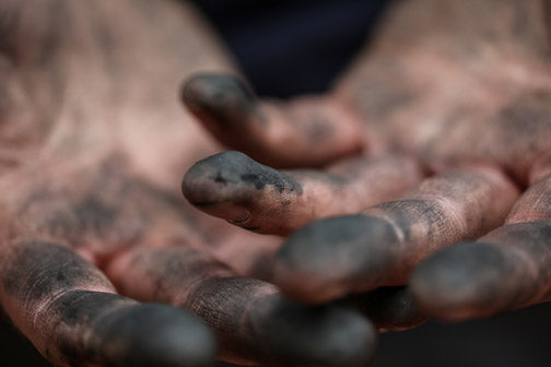 Maker's hands, dirty with dye.