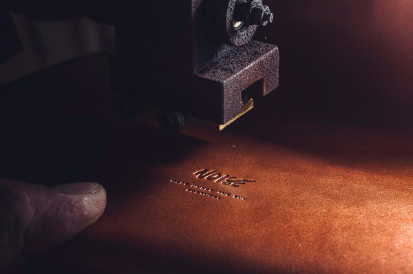 Vegetable-tanned leather being stamped