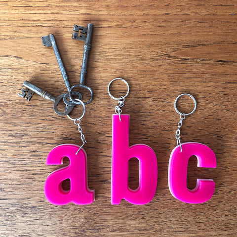 Reclaimed Letter Keyrings - Pink on white Perspex