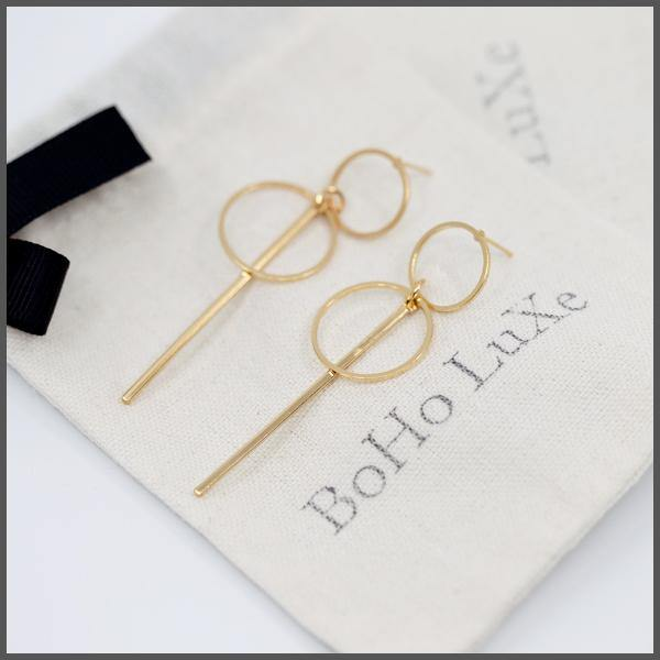 gold simple two hoop and bar drop earrings on boho luxe gift bag