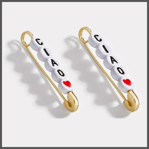 ciao written on white beads threaded on a safety pin