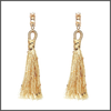 gold drop earrings with a shimmering long cotton tassels