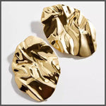 dramatic large gold crumpled statement earrings