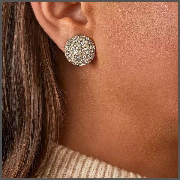 Gorgeous button stud gold earrings covered with shimmering crystals of various sizes on girl models ear