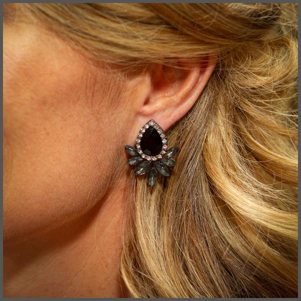 smokey charcoal tear drop encrusted with crystals around the outside with smokey crystal leaves underneath on girl model ear