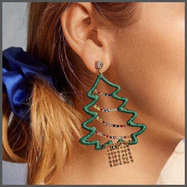a green Christmas tree motif dangle earring with crystal embellishments