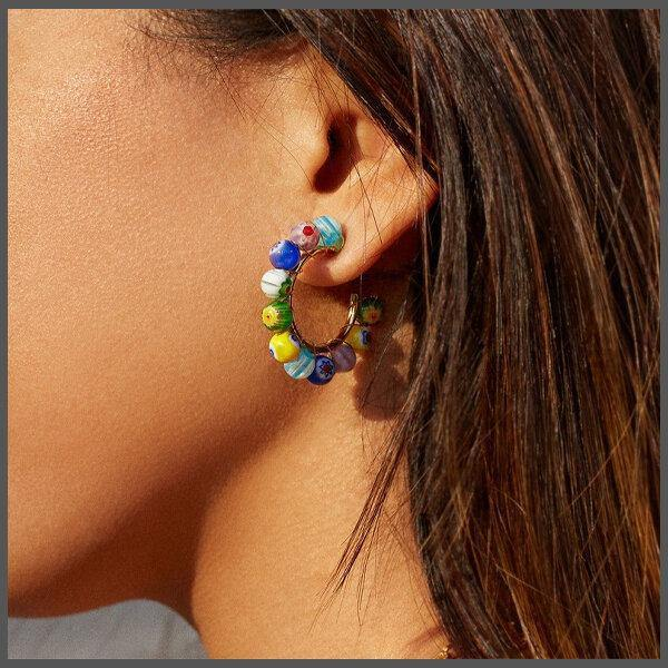 medium gold hoop covered with colourful Venetian Murano glass beads that are hand painted in various primary colours on girl model ear