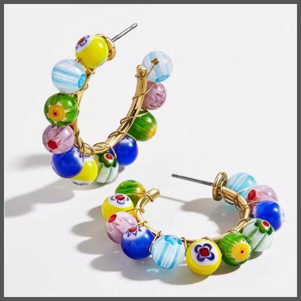medium gold hoop covered with colourful Venetian Murano glass beads that are hand painted in various primary colours