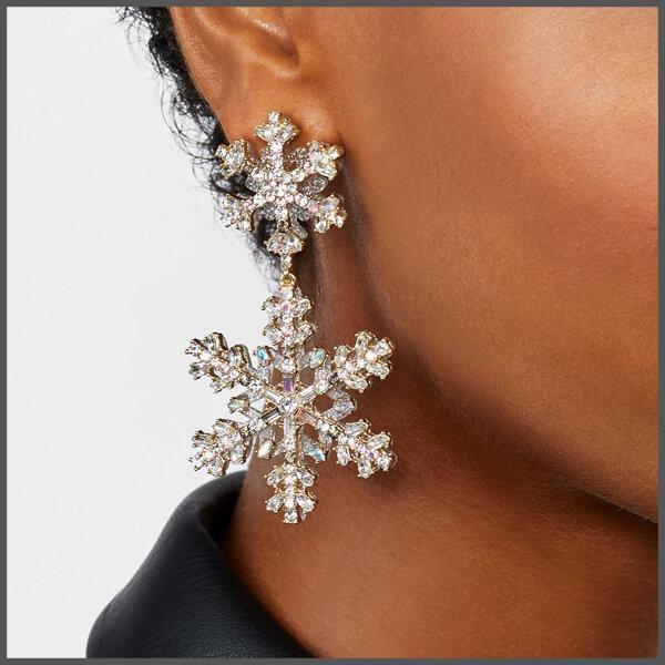 champagne encrusted snow flake crystal drop medium sized earrings on girl model ear
