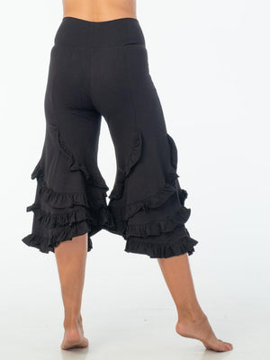 CARAUCCI women's ruffle bloomer pants are shown in black are made from cotton lycra jersey and have a loose fit silhouette.