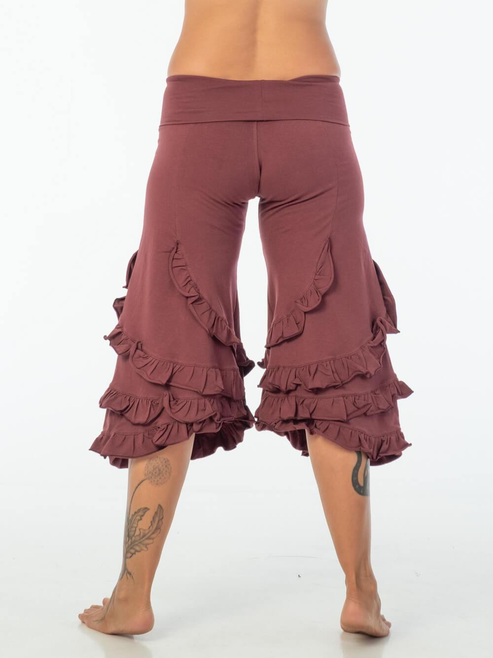 CARAUCCI women's ruffle bloomer pants are shown in ruby are made from cotton lycra jersey and have a loose fit silhouette.