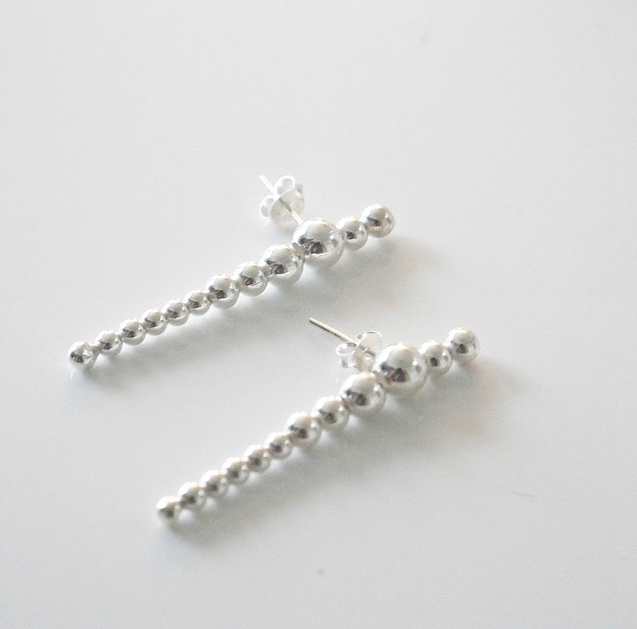 Delusion Linear Ball Earrings