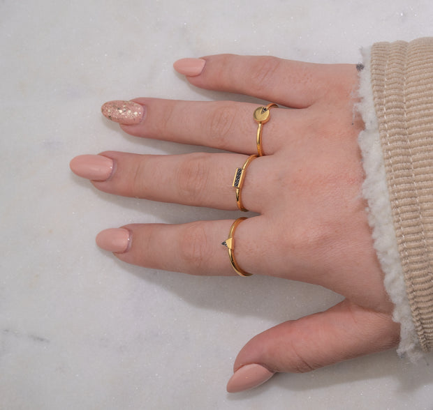Jewellery hand model wearing three Asena Boutique 18k gold plated rings