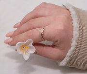 fashion hand model wearing18k gold plated ring, moonstone centre with mini CZ