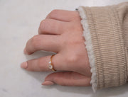 Jewellery hand models wearing 18k gold ring plated with a moonstone and fresh water pearl