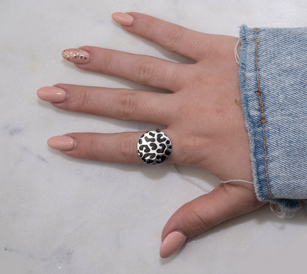 Jewellery hand model wearing Silver fashion statement ring with leopard print black enamel
