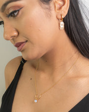Fashion model wearing 18k gold plated necklace with moonstone pendant. Crescent necklace. Necklace length
