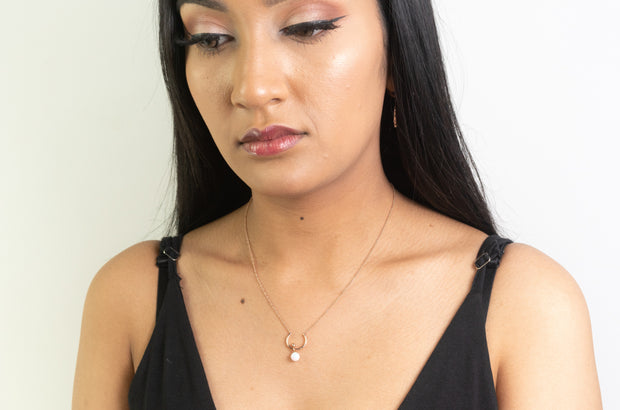 Fashion model wearing Rose gold necklace plated, crescent shape on fashion model with moonstone